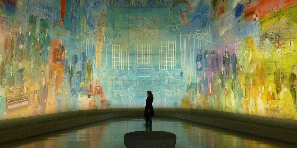 A painted mural wraps around an entire gallery room