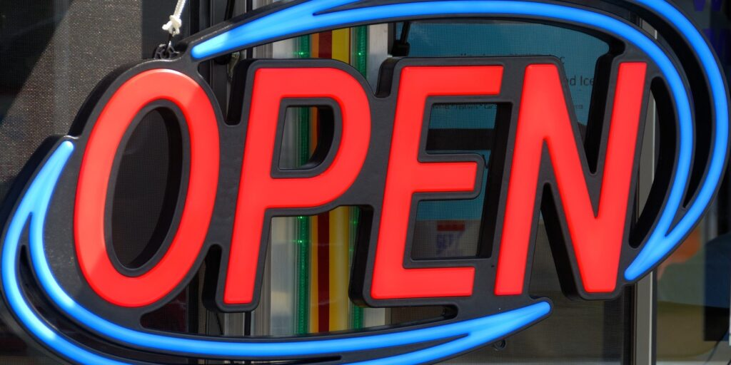 """An """"Open"""" sign from a store window"""