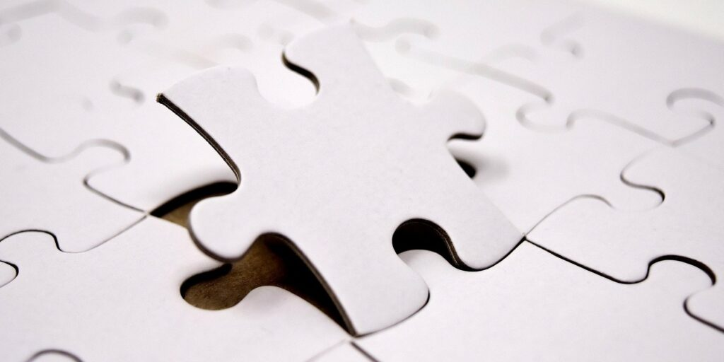 Placing a puzzle piece into a completed puzzle