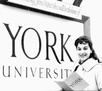Girl standing in front of York University sign in black and white