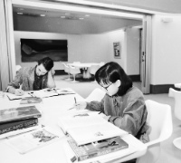 Two women sitting in archives in black and white Image