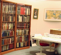 Image of bookshelf and study table with chairs