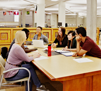 Image of students sitting in a group