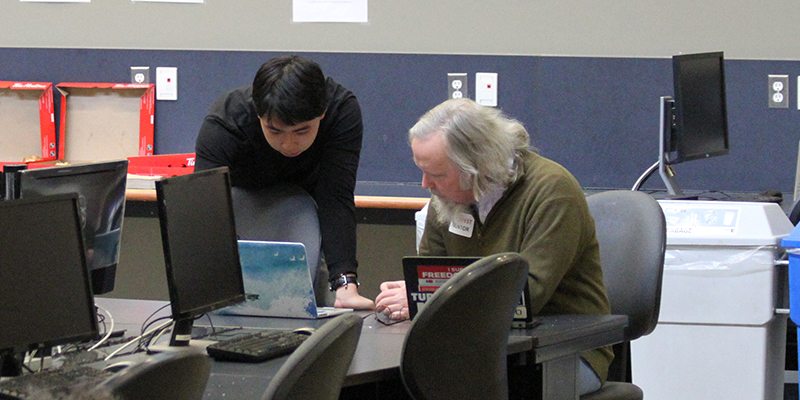 Luke Liu of Team SWA works with one of the mentors on hand at Hackfest