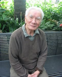 Photo of Jerome Ch'en sitting on a bench. Ch'en, a former Professor at York University, passed away on June 17, 2019