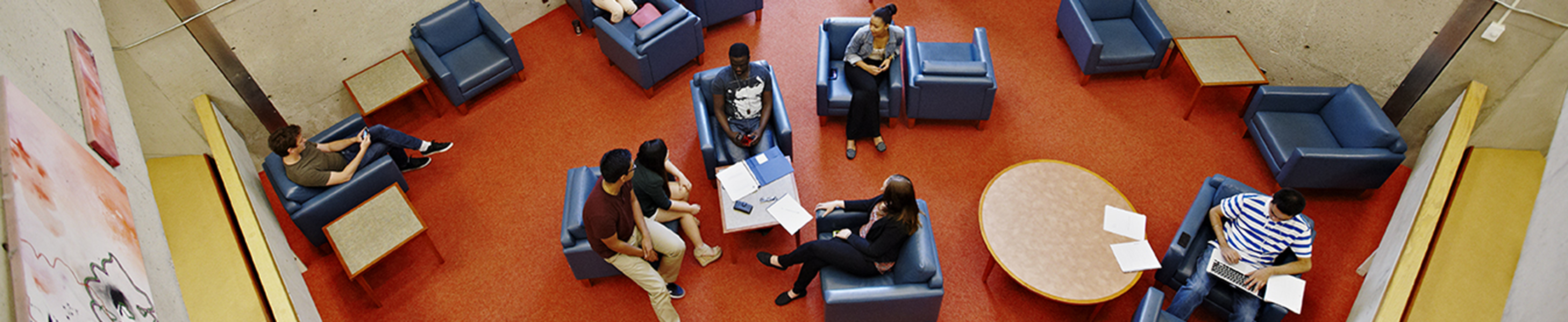 Aerial photo of students working and talking in a lounge at Scott Library - used as a header for the SLAS website